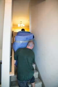Movers carry large piece of furniture down the staircase 497144893 3840x5760 200x300